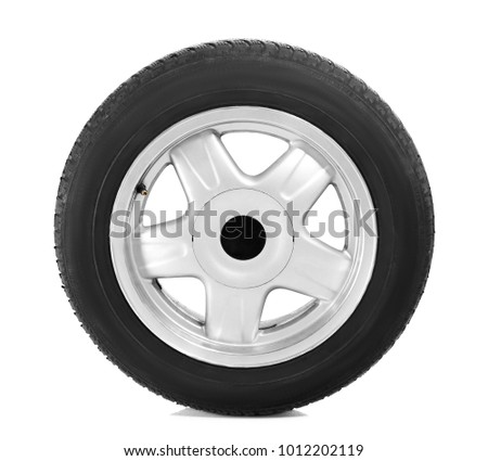 Car tire with wheel on white background