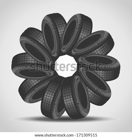 Car tires arranged in a circle - stock photo