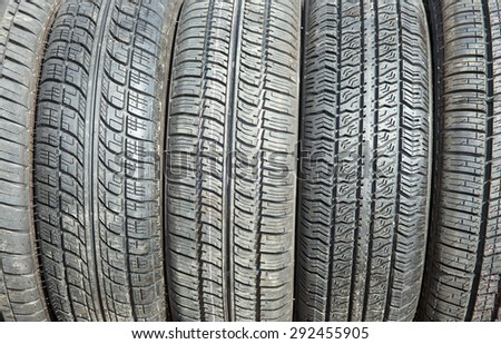Car tires background. Selective focus. - stock photo