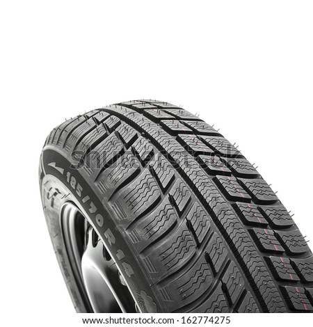 Car tires close-up Winter wheel profile structure on white background - stock photo
