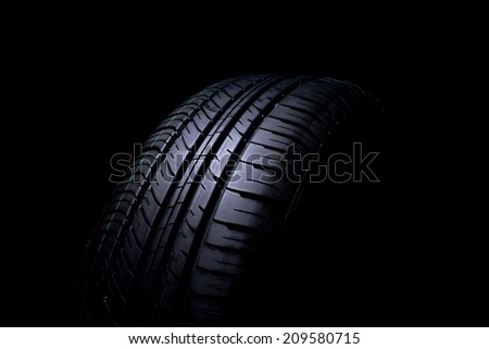 Car tires isolated on black background  - stock photo