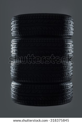 Car tires isolated on gray background - stock photo