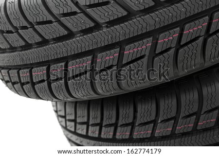 Car tires mature stack close-up Winter wheel profile structure on white background