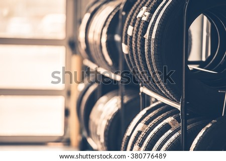 Car Tires Rack. Brand New Tires for Compact Vehicles on the Metal Display.