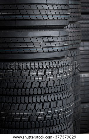 Car tires stack tire in store house at sale at a tire store - stock photo
