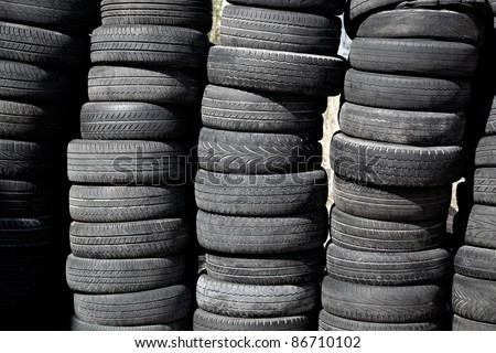 car tires used  pneus stacked in rows for recycle - stock photo