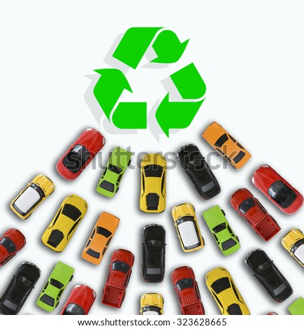 Car toys heading towards a green energy symbol or sign suggesting sales growth of electric vehicles - stock photo