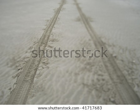 car trace in the sand - stock photo