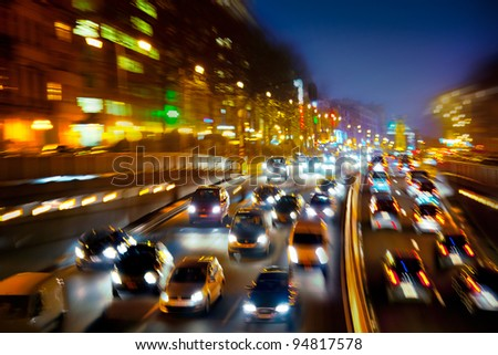 Car traffic at night. Motion blurr?d. Background. - stock photo