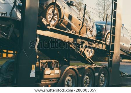 Car Transporter parked on road side vintage filter effect - stock photo
