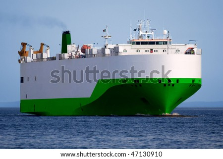 Car Transporter underway at sea. - stock photo