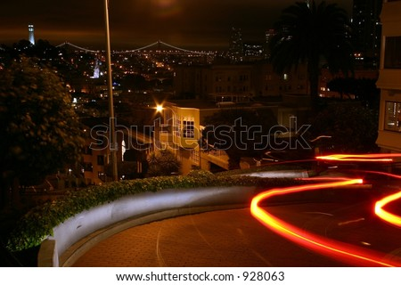 Car Traveling Down Lombard Street in San Francisco - stock photo