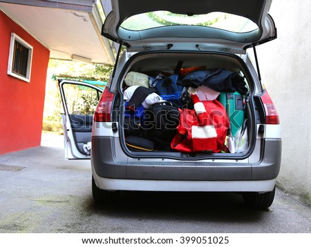 car trunk loaded with bags and luggage before the holiday departures - stock photo