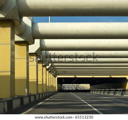 Car tunnel in urban city - stock photo
