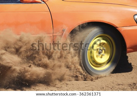 Car turning in dirt road. - stock photo