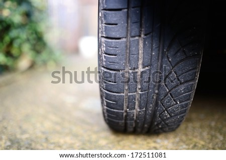 Car tyre - automobile background - stock photo