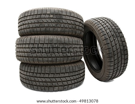 Car tyres in a pile isolated on white - stock photo