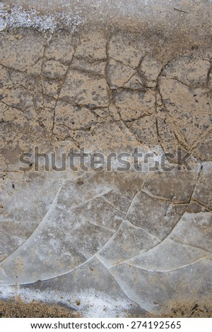Car tyres print on icy and dirty surface. - stock photo