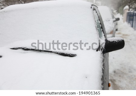 Car under snow white outdoor - stock photo
