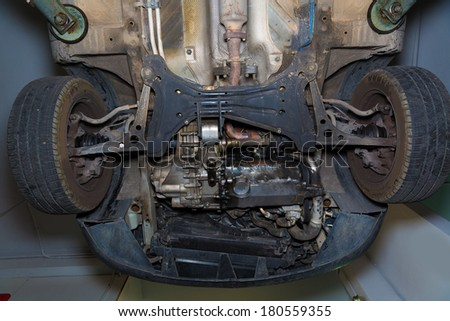 Car underbody  front enginee wheels drives suspension radiator of used car - stock photo