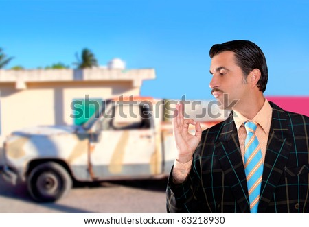 car used salesperson selling old car as brand new  typical topic salesman with hand ok gesture [Photo Illustration] - stock photo