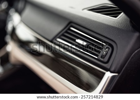 Car ventilation system with adjustment buttons and details of modern car - stock photo