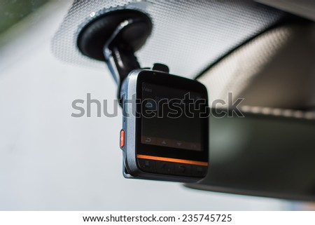 car video recorder installed on the window - stock photo