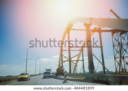 Car view over the steel bridge in summer day