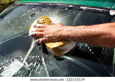 car wash with a sponge and soap - stock photo