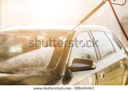 Car wash with high pressure washer,close up - stock photo