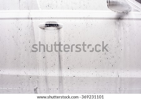 Car washing process  of luxury car full covered with white foam and bubbles close up foam texture  - stock photo
