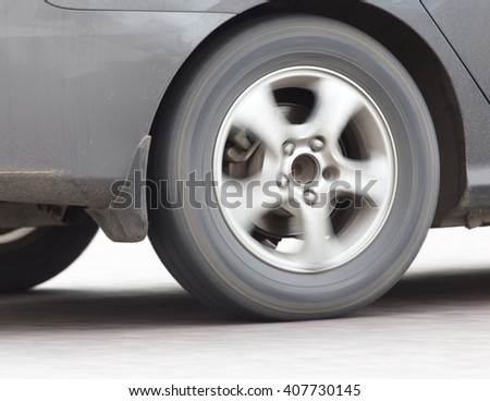 car wheel in motion on the road