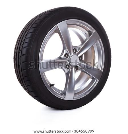 Car wheel isolated on white background. - stock photo