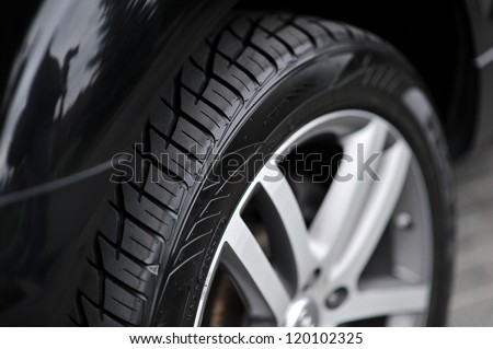 Car wheel on a car - closeup - stock photo