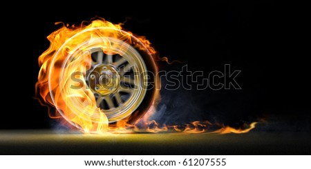 car wheel on fire - stock photo