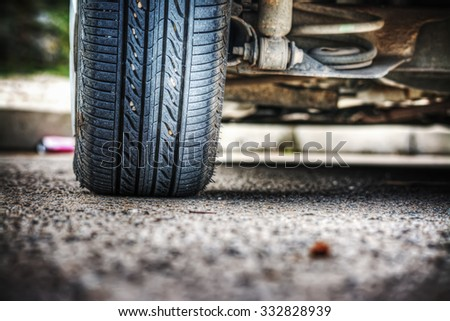 car wheel on the ground seen from behind - stock photo