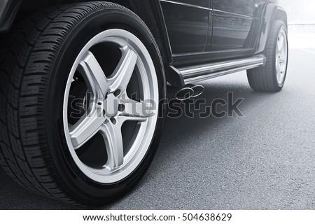 car wheels close up on a background of asphalt car tires car wheel close