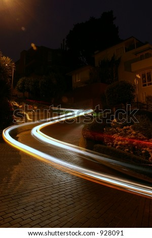Car Winding Down Lombard Street in San Francisco - stock photo