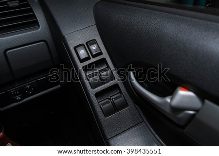 car window control buttons ; Interior details.