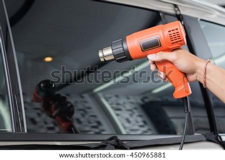 Car window tinting series : Heat shrinking window film - stock photo