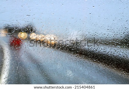 Car windshield in traffic jam during rain  - stock photo