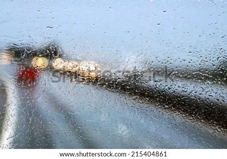 Car windshield in traffic jam during rain  - stock photo