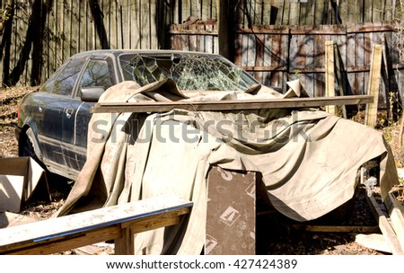 car with a broken windshield - stock photo