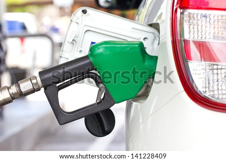 Car With A Gas Pump. - stock photo