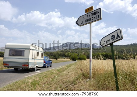 Car with caravan on its way to a French camping - stock photo