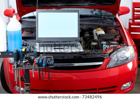 Car with open hood in auto repair shop. - stock photo
