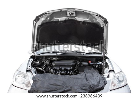 Car with open hood in auto repair shop isolated on white background with clipping path - stock photo