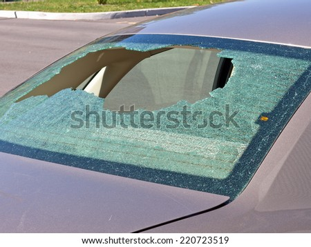 Car with Shattered Rear Window - stock photo