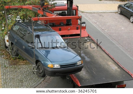 car with tow truck - stock photo