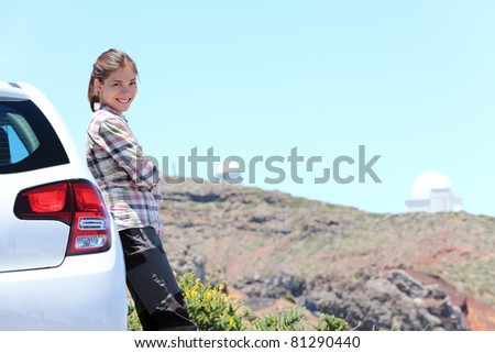 Car woman road trip on La Palma, Canary Islands. Observatory at Roque de los Muchachos in background. - stock photo